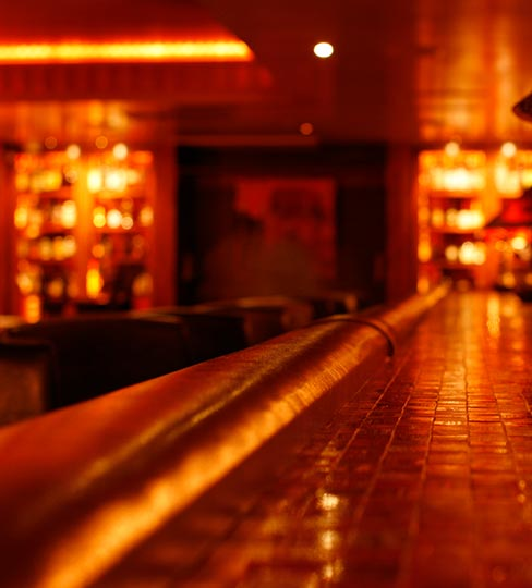 Dimly lit speakeasy bar in savannah