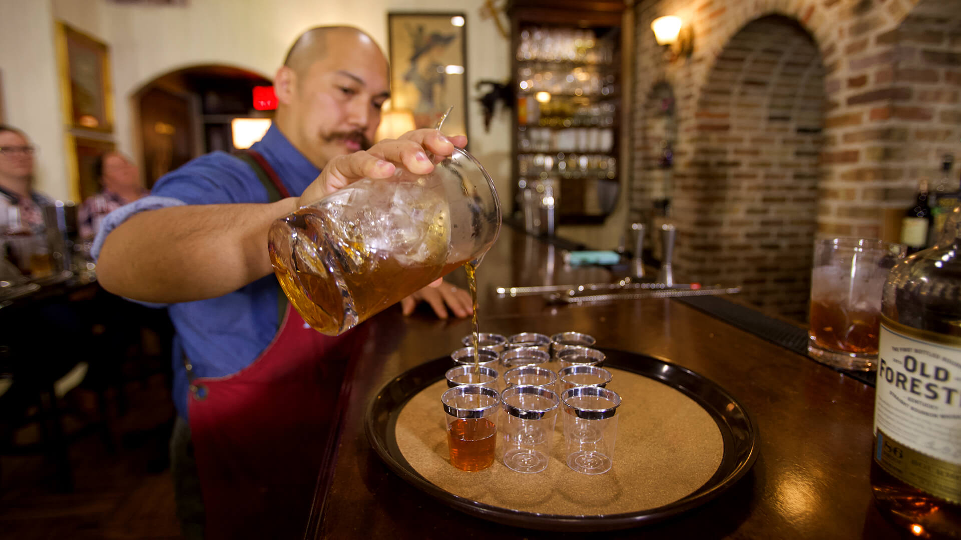 Bartender pouring prohibition style shots at Savannah Speakeasy Cocktail Class