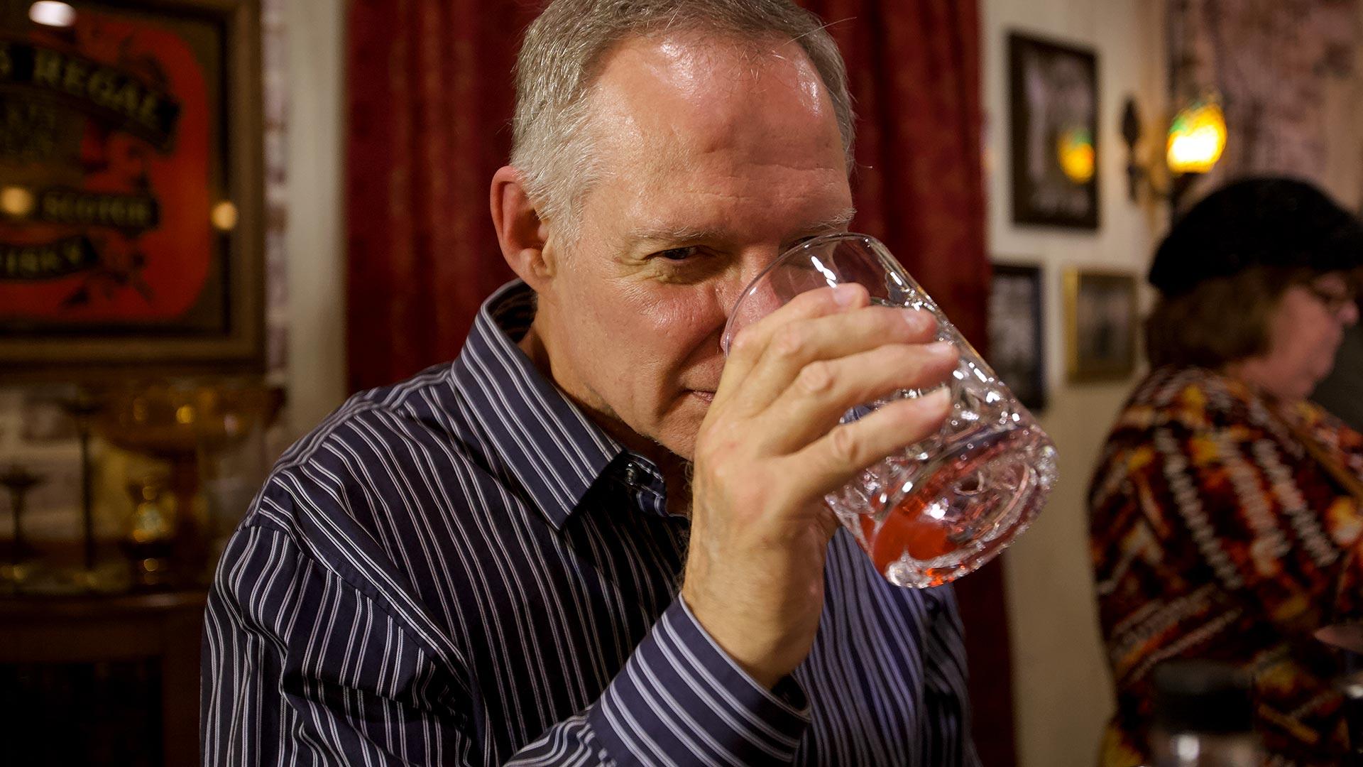 Customer tasting whiskey at Savannah Speakeasy whiskey Class